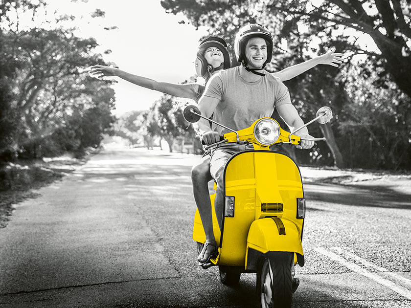 Couple on yellow scooter